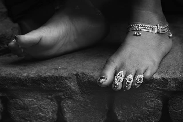 woman with toe rings
