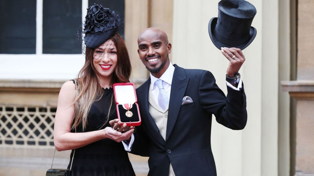 Four-time Olympic champion Sir Mo Farah with wife Tania after he was awarded a Knighthood by Queen Elizabeth II at an Investiture ceremony at Buckingham Palace, London. PRESS ASSOCIATION Photo. Picture date: Tuesday November 14, 2017. See PA story ROYAL Investiture. Photo credit should read: Jonathan Brady/PA Wire